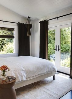 In the bedroom, Martins sourced a pendant light fixture made from an old bullet cap from Artefact Design & Salvage in Sonoma; the hair-on-hide rug is from B