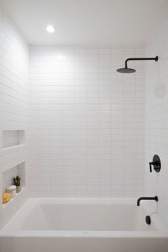 Bath Room Recessed Lighting Soaking Tub Full Shower Subway Tile Wall and Ceiling Lighting Each bathroom features matte black hardware and oversized Phylrich rain shower heads. Photo 11 of 107 in Best Bath Subway Tile Photos from Raber By VEIN White Subway Tile Bathroom, Subway Tile Showers, White Tiles, Bathroom Feature Wall Tile, Black Bathroom Light, Modern White Bathroom, Upstairs Bathrooms, Basement Bathroom, Modern Bathrooms