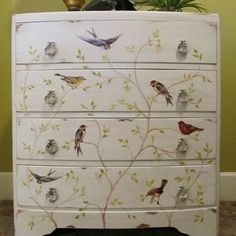 how cool. The birds have been created by decopaging pictures on to the draws. The branches and leaves were painted on