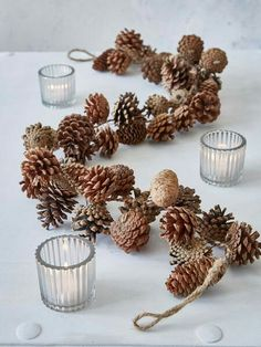 This lovely pine garland will add a cosy rustic ski-lodge charm to your festive decorations. - Mona McKinnerney - - This lovely pine garland will add a cosy rustic ski-lodge charm to your festive decorations. Rustic Christmas, Simple Christmas, Christmas Crafts, Christmas Ornaments, Christmas Christmas, Primitive Christmas, Father Christmas, Scandinavian Christmas, Beautiful Christmas
