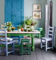 This painted dining room brings together a range of colours from the Annie Sloan palette, focusing on blues and greens, with pops of pale pinks and lilacs.