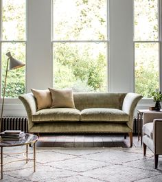 "An unusual and very elegant classic design that can be equally at home in a contemporary or traditional setting.  Available in any fabric Show in Como silk velvet -fern Warwick sofa - UF120 W210cm x H85cm x D86cm / W86½"" x H33½"" x D33¾"" Seat height 55cm / 21¾"" Seat depth 59cm / 23¼"" Fabric requirement*15-16m / 16½-17½yd * based on standard fabric width of 137cm / 54"". Subject to fabric repeat."