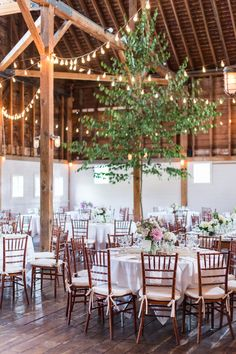 Photography : Leila Brewster |  Wedding Reception | Flower Centerpieces | Wood Chairs | Romantic | True Event | http://www.trueevent.com http://www.stylemepretty.com/2015/12/23/gedney-farm-massachusetts-wedding/