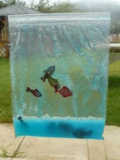 """Aquarium tactile On the theme """"April and its fish"""", I proposed to the toddlers a sensory a Ocean Crafts, Fish Crafts, Diy And Crafts, Montessori Activities, Infant Activities, Activities For Kids, Baby Sensory, Sensory Play, Diy For Kids"""