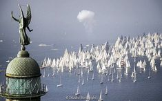 Thousands of sailboats prepare to race at yesterdays Barcolana the largest regatta in the world. The Regata Barcolana is held each year in Trieste. Trieste, Italy News, Elle Decor, Sailing, Chandelier, Ceiling Lights, World, Sailboats, Grande