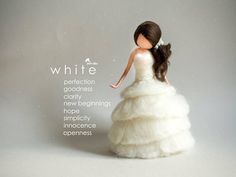 White is a very positive color, associated with light, purity, goodness, heaven, safety, brilliance,spirituality, and perfection. The dress of this exclusive fairy is carefully decorated with Swarovski crystals. She is dressed for special occasions like Christmas or Wedding. She