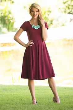 "This classic fit-and-flare dress is available in a brand new color, just in time for Fall! Simple & beautiful, this flattering dress works for every occassion, from church to bridemaids!  ""Ivy"" Modest Dress in Cranberry"