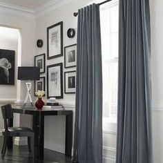 Study - off white walls with grey curtains and black and white photos