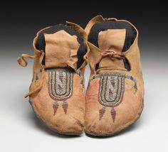 A PAIR OF CROW BEADED HIDE MOCCASINS. . c. 1880. ... American | Lot #77315 | Heritage Auctions