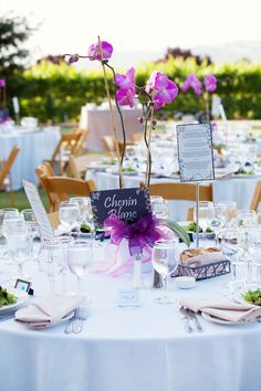 Beautifully set table for an outdoor wedding reception. If you know me, you know I love orchids! I think I would be just fine with this simple centerpiece! LOVE!