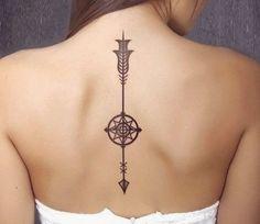 simple arrow tattoo on back