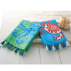"""We LOVE these whimsical sea life motif towels. They measure about 21"""" x 14"""" and are made of starched linen. Each features cute little tassels and either an appliqued octopus or an appliqued crab set on an all over wave pattern.   They come with an attached tag, where on the back it has a """"To:"""" ..."""