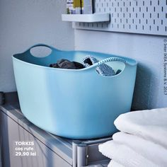 A large blue laundry basket sits on top of a cabinet. Fabric Shaver, My House Plans, Ikea Shopping, Ikea Home, Wall Racks, Laundry Basket, Laundry Room, Outdoor Cooking