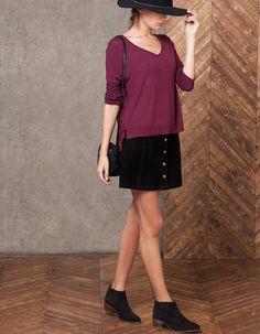 burgundy V neck top with black top