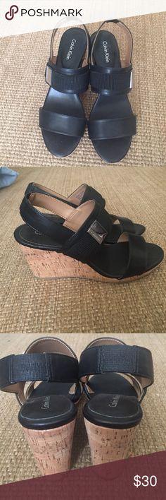 Calvin Klein Wedge Heels 7.5 Size Black Leather Calvin Klein Black Leather Wedge Heels; 7.5 Size; Excellent Condition; Silver Buckle Design on side of strap Calvin Klein Shoes Platforms