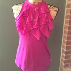 Bright Fuchsia Ruffle Top Soft and silky sleeveless blouse with cascading ruffles down the front.  Ties at the back of the neck.  100% nylon so it's hand washable. La Befana Tops Blouses