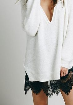 Oversized white knit sweater and black lace slip dress