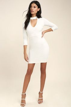 You'll be the envy of everyone in the room in the Seven Wonders Ivory Bodycon Dress! Medium weight stretch knit covers a darted, three quarter sleeve bodice with a mock neck, front cutout, and a figure-flaunting skirt. Hidden back zipper/hook clasp.
