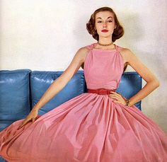 Pretty in Pink 1952. Love the tiny waist and big skirt