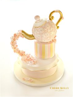 Gold Teapot Cake with a pouring Cascade of Pastel pink and peach Flowers Alice in the Wonderland Mad Hatter Themed Tea Party Cherie Kelly London