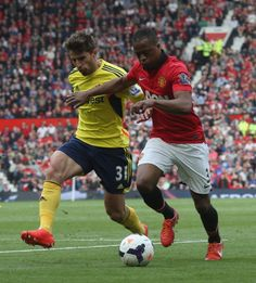 Patrice Evra of Manchester United in action with Fabio Borini of... ニュース写真 487982465
