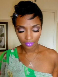 Smokey light eyeshadow and bright purple lips