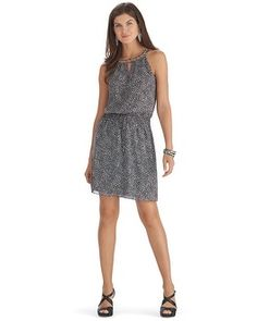 Mexico? $45 WHBM - Smocked stretch waist creates a beautiful blouson shape on this sublimely soft dress in alluring black and white print. Cut-in style shoulders with silvertone beaded touches woven in through the neckline.
