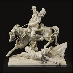 An Ivory sculpture of a Cossack in combat, late 19th Century.