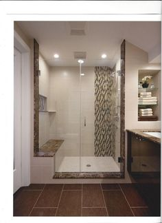 I like the tiled seat, partial door without a frame and the matching tile strip for design and visual tie in Custom Bathroom