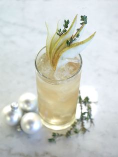 A Partridge in a Pear Tree: Absolut Pear, lemon juice, caramel syrup, apple juice and thyme #cocktails #drinks #alcohol