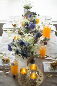#rustic, #tablescapes, #silver, #brunch, #centerpiece, #tablecloth, #french-country, #votives, #country, #linen, #neutral, #white, #french, #purple  Photography: Dennis Wise  Read More: http://www.stylemepretty.com/living/2013/09/11/french-country-inspired-lunch/