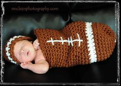 A baby in a football!!