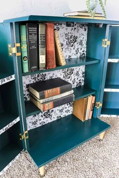 I'm SO glad that I decided to add in the contact paper, rather than paint the back of these boho style bookshelves. I think it adds so much extra character. You can do the same thing with peel and stick wallpaper. #DIY #bookcase #contactpaper #wallpaper #DIY
