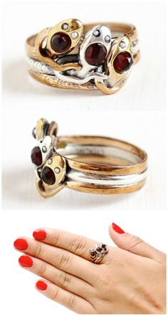 A stunning antique triple snake ring from the 1930's with garnet-set snake heads and pearl eyes in gold fill and sterling silver. Circa 1930's; at Maejean Vintage.