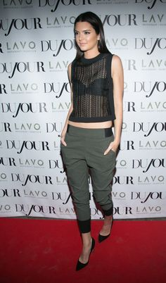 A mesh tank and olive track pants later, Kendall works the perfect red carpet look.