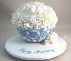 Gorgeous wedgewood blue bowl full of beautiful flowers. By Planet Cake