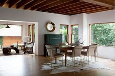 Love when mid-century is heavily infused with natural elements like drift wood, animal hides and antlers.