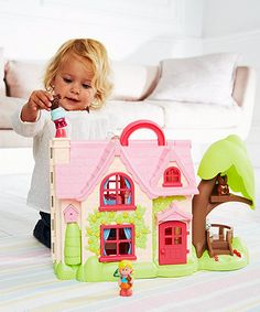 Happyland Cherry Lane Cottage is the perfect first dolls' house for your young child. It comes complete with dolls and furniture too.