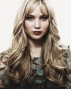 Jennifer Lawrence - long layered cut with face framing. Minimal texturizing.
