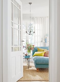 white on white until you get to the blue couch and bright pillows!