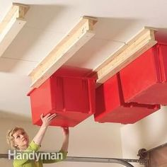 This Sliding Storage System might work in the garage if we could find some nice heavy-duty bins...