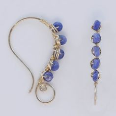 Unique shape of these curved hand formed and hammered 14k gold filled wires offer the perfect setting for the five dreamy blue faceted Tanzanite rondelles. Hand crafted in the USA