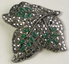 Marcasite and green glass stones dress clip.  Photographed by Gillian Horsup.