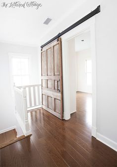 Top 20 Barn Doors | The Blissful Bee.  love this door!!