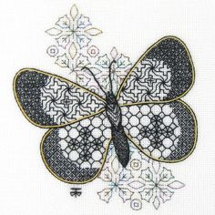 Butterfly worked in blackwork and outlined with couched gold thread.