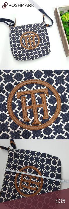 Tommy Hilfiger Crossbody Purse Tommy Hilfiger navy and white crossbody purse. has adjustable strap. Inside zipper pocket and open pockets. Tommy Hilfiger Bags Crossbody Bags