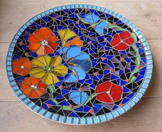 Gorgeous!  Would make a wonderful design for a bird bath in my backyard fantasy garden! Mosaic flower bowl by Bricolore (Bri), via Flickr
