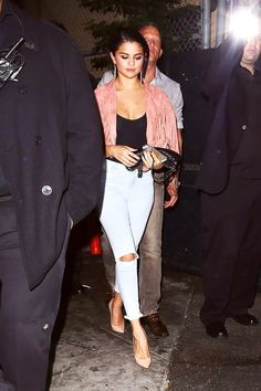Selena Gomez sports pink fringe and ripped jeans for dinner at Abbey Food & Bar in West Hollywood, California. August 2, 2014.