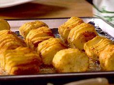 Robert Irvine and Paula Deen make Hasselback roasted potatoes.