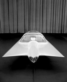 FORD GYRON CONCEPT CAR, 1961    A two-wheeled gyrocar first shown in 1961 as a concept car. One wheel was at the front and the other at the rear like a motorcycle and the car was stabilized by gyroscopes. When the vehicle was stationary, two small legs appeared from the sides to support it.'    - Wikipedia